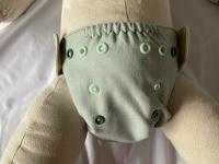 Puppi merino uld cover - newborn - trykknapper - iguana